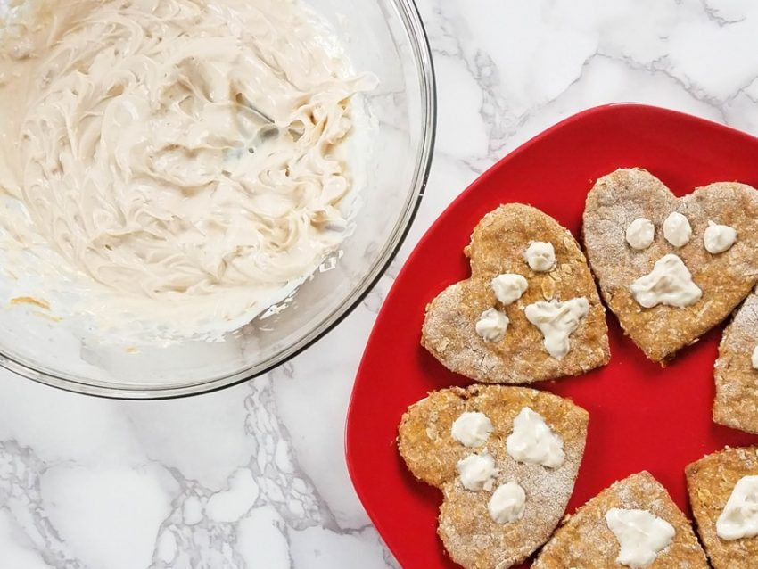 Celebrate Love Your Pet Day everyday with these adorable & tasty homemade heart-shaped dog biscuits! Grab the recipe now!